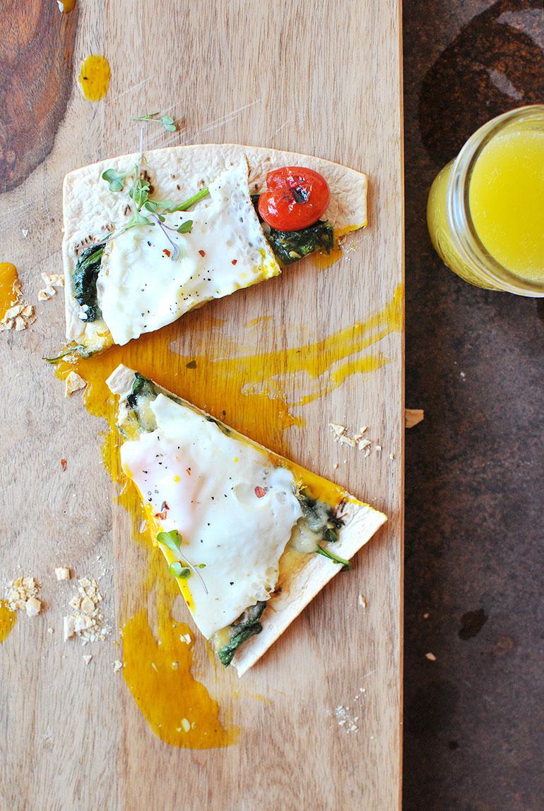 breakfast pizza on cutting board