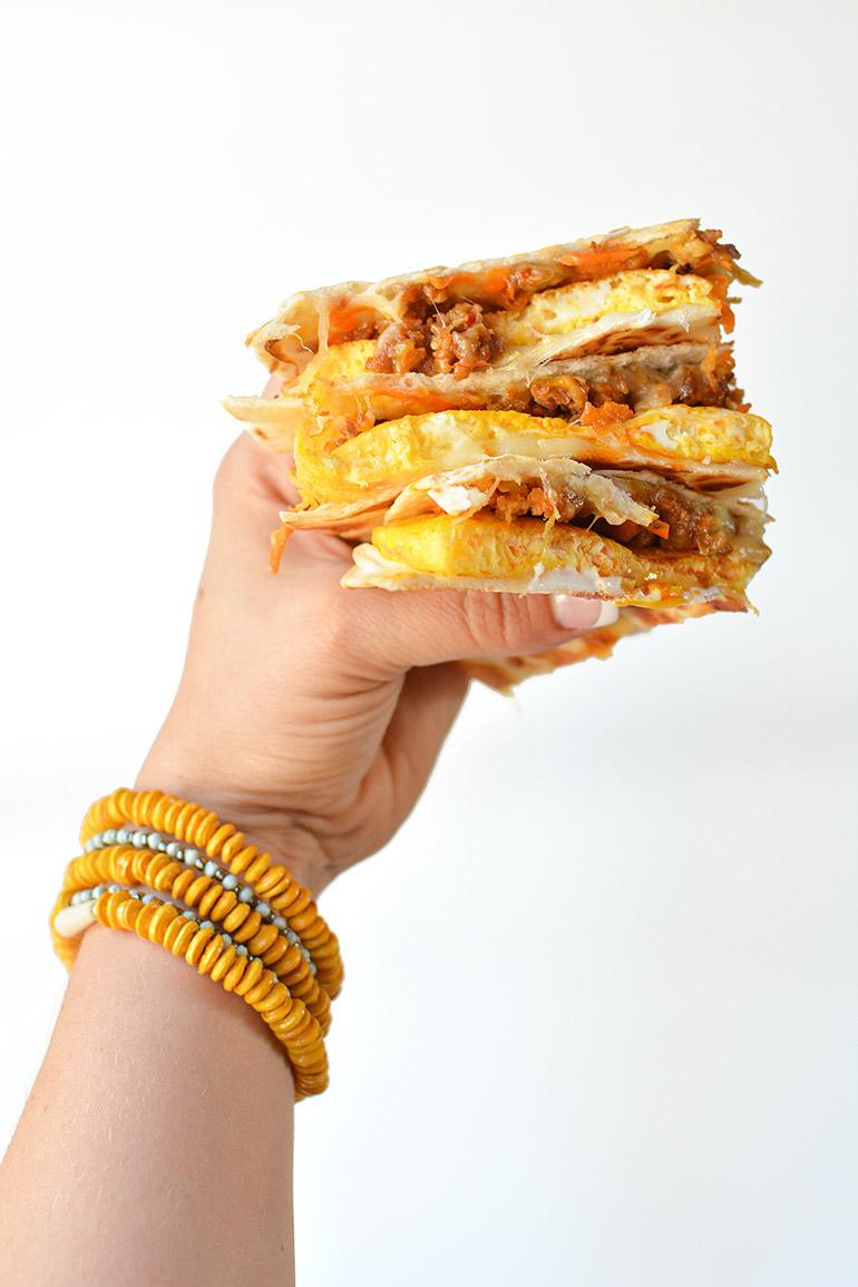 breakfast quesadillas in hand