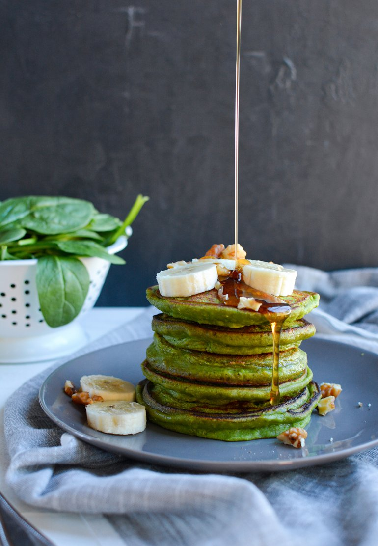 green smoothie pancakes with syrup drip