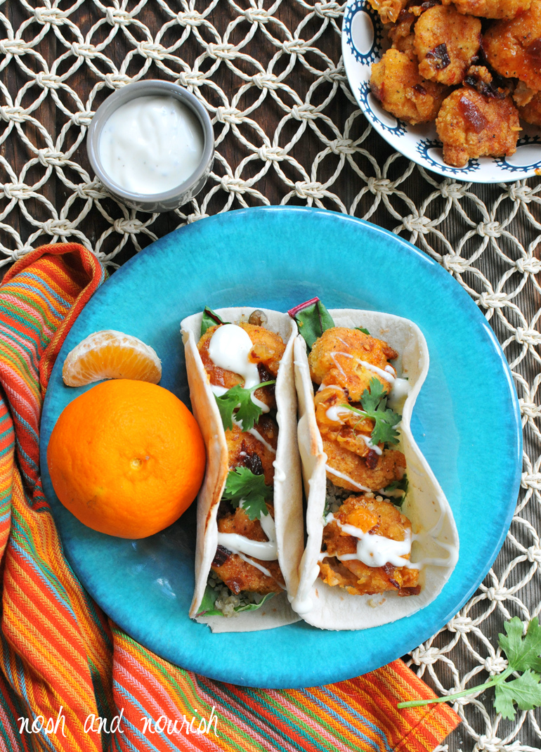 criispy honey chipotle shrimp tacos on a plate