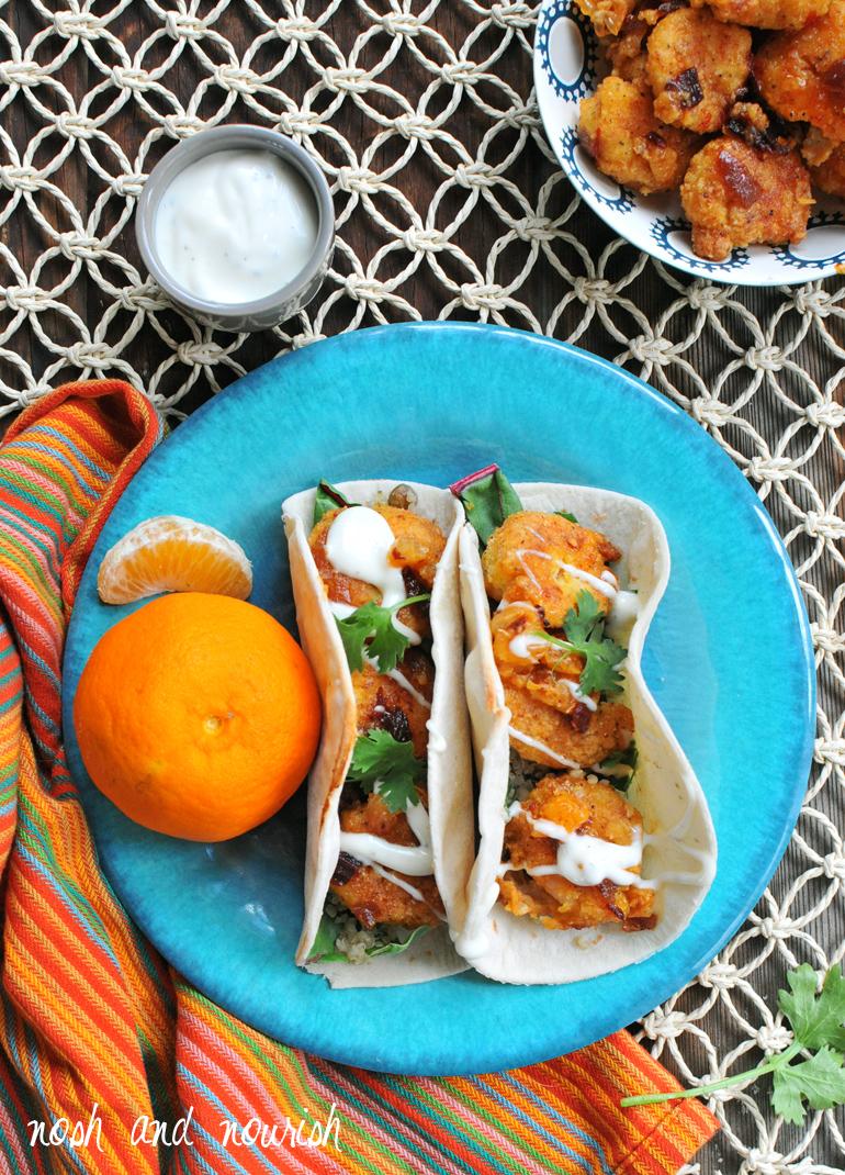 criispy honey chipotle shrimp tacos on a plate