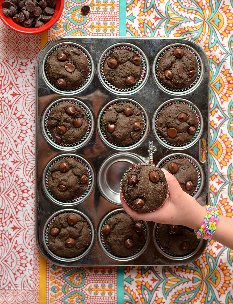 grabbing chocolate avocado muffin