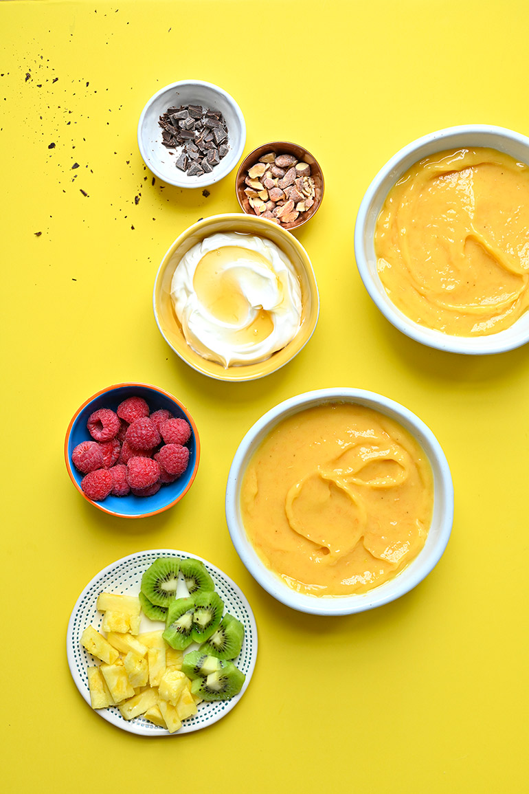 mango creamsicle smoothie bowl and toppings