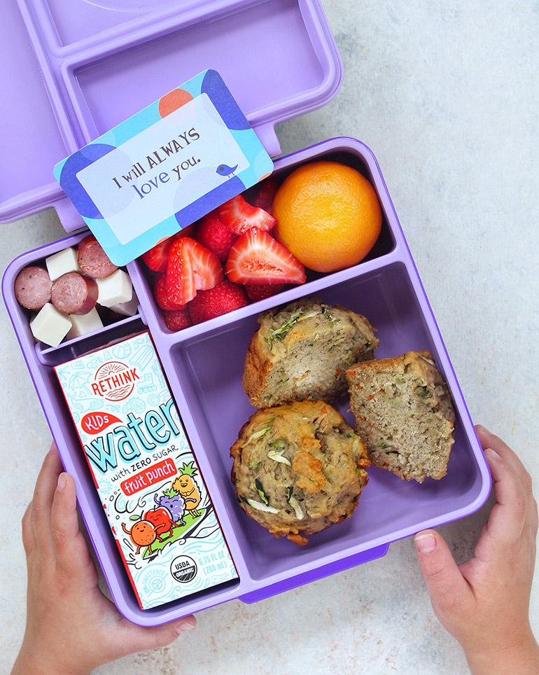 purple lunchbox with zucchini muffins