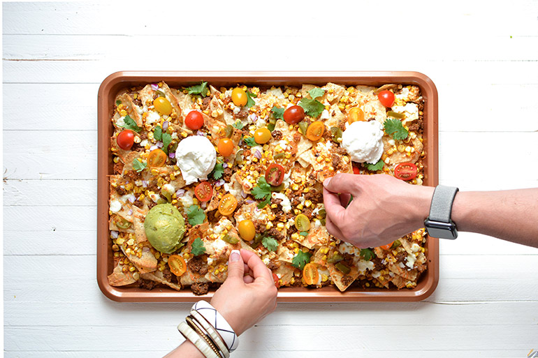 tray of nachos with village farms tomatoes