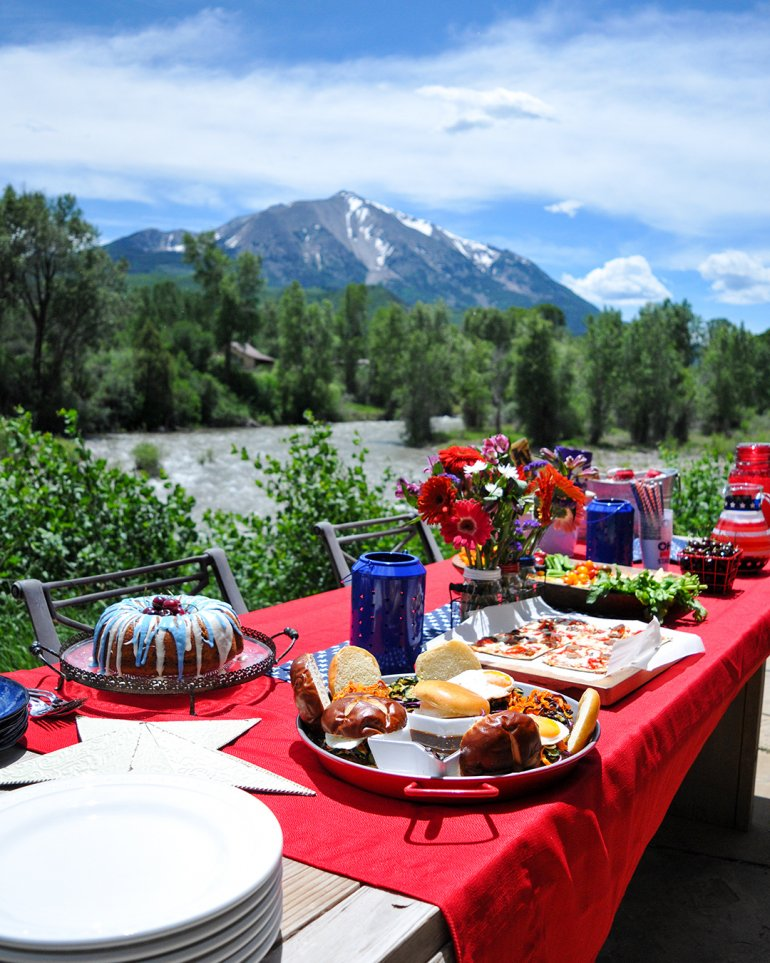 summer bbq picnic spread with mountains