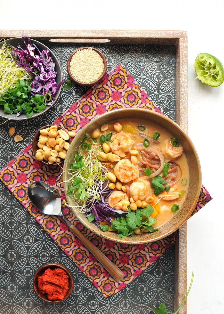 thai shrimp curry bowl with cabbage and sprouts