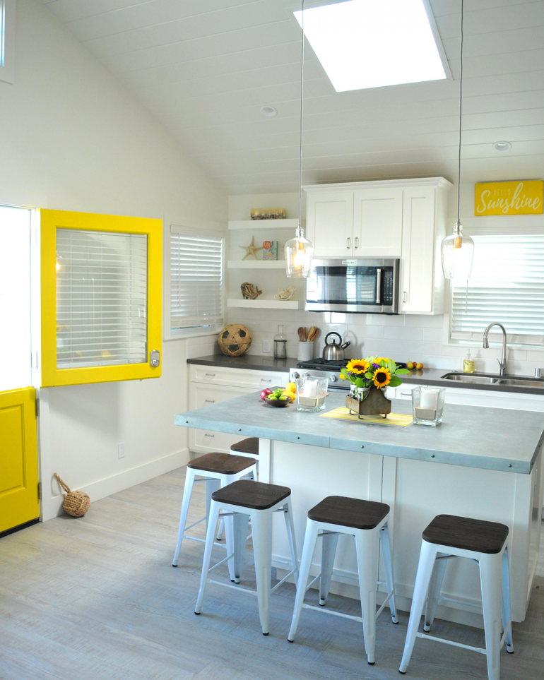 cute bright white kitchen with yellow accents