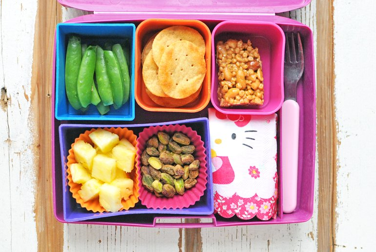 Lunchbox Filled with Snacks that Start with the Letter P